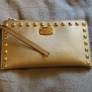 Micheal Kors Wristlet in Gold